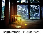 fireflies in a jar in a child's ...   Shutterstock . vector #1103858924