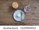 flat lay iced coffee  flower...   Shutterstock . vector #1103904914