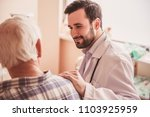 handsome doctor is talking with ... | Shutterstock . vector #1103925959