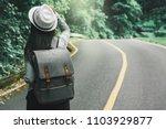 traveler asian woman with... | Shutterstock . vector #1103929877
