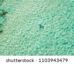 an aerial view of a surfer... | Shutterstock . vector #1103943479