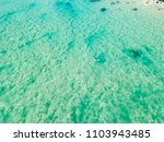 an aerial view of a surfer... | Shutterstock . vector #1103943485