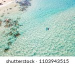 an aerial view of a surfer... | Shutterstock . vector #1103943515