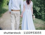 the hands of the newlyweds | Shutterstock . vector #1103953055