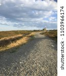 Small photo of Path in paltry landscape