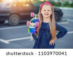 a fashionable little cute girl... | Shutterstock . vector #1103970041