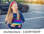a fashionable little cute girl... | Shutterstock . vector #1103970059
