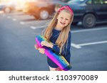 a fashionable little cute girl... | Shutterstock . vector #1103970089