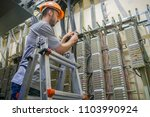 a worker standing on the stairs ... | Shutterstock . vector #1103990924
