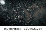 Stock photo aerial shot of the battlefield where armies of medieval warriors fighting medieval reenactment 1104021299
