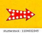 red arrow shaped vintage... | Shutterstock . vector #1104032345