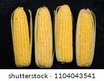whole sweetcorn cob on dark...   Shutterstock . vector #1104043541