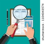 accountant with report ... | Shutterstock .eps vector #1104043574