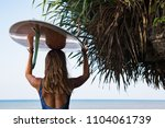 sporty girl in bikini with surf ... | Shutterstock . vector #1104061739