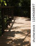 wood walk with sunlight | Shutterstock . vector #1104068897