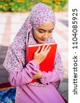 Small photo of Muslim young women reading quran in mosque Muslim people respect islam Islam is religion