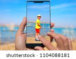 woman with mobile phone photos... | Shutterstock . vector #1104088181