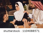the arab husband apologizes to... | Shutterstock . vector #1104088571