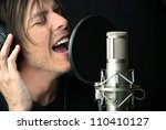 close up of a man singing into... | Shutterstock . vector #110410127