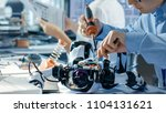 electronics engineer works with ... | Shutterstock . vector #1104131621