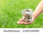 hands holding glass jar with... | Shutterstock . vector #1104134981
