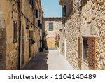 old village street grunge house ... | Shutterstock . vector #1104140489