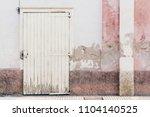 house grunge facade pink white... | Shutterstock . vector #1104140525