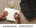 the man is drawing and created... | Shutterstock . vector #1104145157