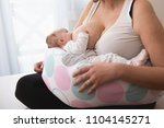 mother breastfeeding baby girl... | Shutterstock . vector #1104145271