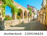 beautiful old stone wall with... | Shutterstock . vector #1104146624