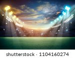stadium in lights and flashes... | Shutterstock . vector #1104160274