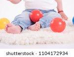 bare baby feet on white... | Shutterstock . vector #1104172934