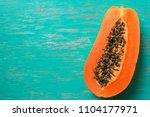 papaya fruit on wooden...   Shutterstock . vector #1104177971