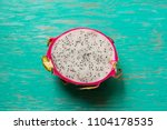 healthy dragon fruits on wooden ...   Shutterstock . vector #1104178535
