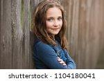 teenage girl wearing denim... | Shutterstock . vector #1104180041