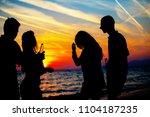 young adult summer beach party... | Shutterstock . vector #1104187235