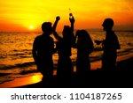 young adult summer beach party... | Shutterstock . vector #1104187265