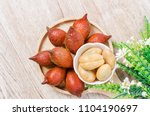 Small photo of Salak Palm , waive or snake fruit in wooden dish on the table.