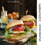 vegetarian burger with grilled... | Shutterstock . vector #1104194894