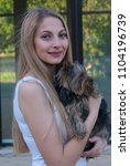 beautiful blonde woman holding...   Shutterstock . vector #1104196739
