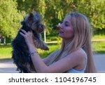 beautiful blonde woman holding...   Shutterstock . vector #1104196745
