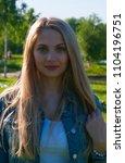 beautiful blonde girl in denim...   Shutterstock . vector #1104196751