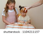 close up portrait of two little ... | Shutterstock . vector #1104211157