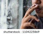 close up young man smoking a... | Shutterstock . vector #1104225869