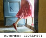 Woman In Pink Steps Over The...