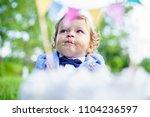 baby boy poking finger in his... | Shutterstock . vector #1104236597