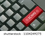 red delete icon with word scams ... | Shutterstock . vector #1104249275