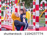 mother and daughter playing at... | Shutterstock . vector #1104257774