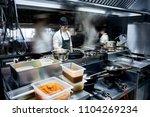motion chefs of a restaurant... | Shutterstock . vector #1104269234