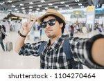 asian man tourist taking a... | Shutterstock . vector #1104270464